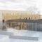 Ny sjukeheim i Bandadalen på Stord. Trekledningsfasade med varierende vinduspartier. Perspektiv mot inngangsparti.