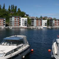 Kopervik Brygge lavblokk leiligheter langs sjøkanten - Arkitektkontoret Brekke Helgeland Brekke AS