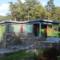Arkitekt Arne Tveit ved Arkitektkontoret Brekke Helgeland Brekke AS har brukt naturstein for å opparbeide uteområdene og nivåene rundt hytta.
