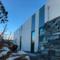Natrusteinsmurer holder Tananger Losstasjon grunnstøtt, tegnet av Arkitektkontoret Brekke Helgeland Brekke AS